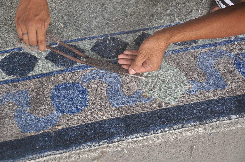 Trimming the carpet with scissors