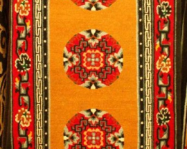 Tibetan carpet with coin design and Border