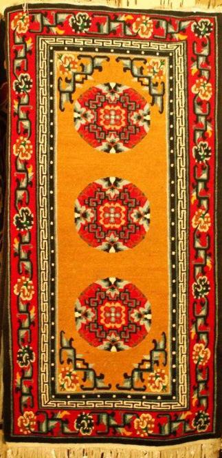 Tibetan carpet with coin design and Border
