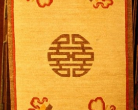 Tibetan carpet with coin and auspicious symbol