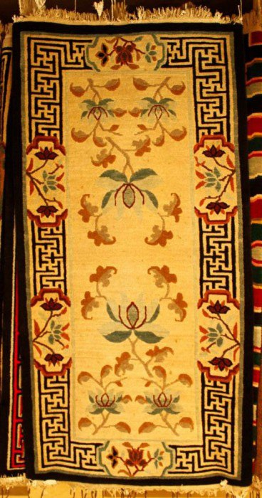 Tibetan carpet with lotus and border